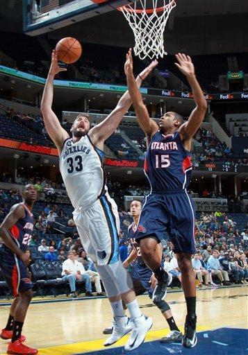 Memphis Grizzlies center Marc Gasol (33), of Spain, shoots and is fouled by Atlanta Hawks forward Al Horford (15), of the Dominican Republic, in the first half of an NBA basketball game on Sunday, Oct. 14, 2012, in Memphis, Tenn. (AP Photo/Nikki Boertman)