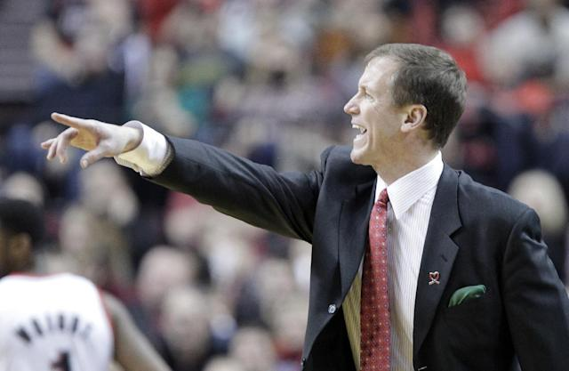 Portland Trail Blazers coach Terry Stotts gestures from the bench during the second half of an NBA basketball game against the New Orleans Pelicans in Portland, Ore., Saturday, Dec. 21, 2013. Portland won 110-107. (AP Photo/Don Ryan)