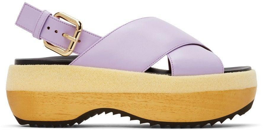 "<h2>Marni Purple Wooden Sole Wedge Sandals<br></h2><br><br><em>Shop sandals at <strong><a href=""https://www.ssense.com/en-us/women/sandals"" rel=""nofollow noopener"" target=""_blank"" data-ylk=""slk:SSENSE"" class=""link rapid-noclick-resp"">SSENSE</a></strong></em><br><br><strong>Marni</strong> Purple Wooden Sole Wedge Sandals, $, available at <a href=""https://go.skimresources.com/?id=30283X879131&url=https%3A%2F%2Fwww.ssense.com%2Fen-us%2Fwomen%2Fproduct%2Fmarni%2Fpurple-wooden-sole-wedge-sandals%2F6767721"" rel=""nofollow noopener"" target=""_blank"" data-ylk=""slk:SSENSE"" class=""link rapid-noclick-resp"">SSENSE</a>"