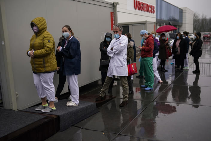 Health care workers wait in line to be vaccinated with Pfizer/Biontech COVID-19 vaccines at the MontLegia CHC hospital in Liege, Belgium, Wednesday, Jan. 27, 2021. The 27-nation EU is coming under criticism for the slow rollout of its vaccination campaign. The bloc, a collection of many of the richest countries in the world, is not faring well in comparison to countries like Israel, the United Kingdom and the United States. (AP Photo/Francisco Seco)
