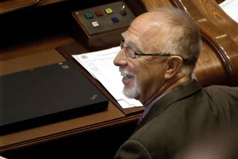 Illinois Sen. Gary Forby, D-Benton, smiles as concealed carry gun legislation passes while on the Senate floor during session at the Illinois State Capitol Tuesday, July 9, 2013, in Springfield, Ill. Illinois became the last state in the nation to allow public possession of concealed guns as lawmakers rushed Tuesday to finalize a proposal ahead of a federal court's deadline. (AP Photo/Seth Perlman)