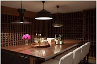 <p>By nature, wine cellars belong underground where it's cooler. If you have a basement, take advantage of the natural climate and build yourself your dream wine cellar. You'll get bonus points for adding a table for tastings, as in this space by Kishani Perera.</p>