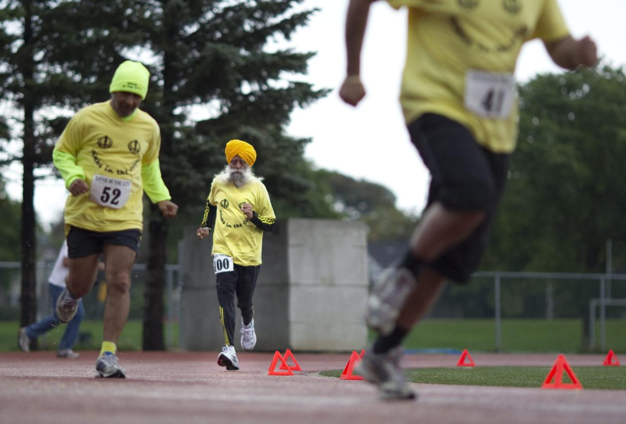 Centenarian Fauja Singh competes in a 200 meter race for centenarians in Toronto, Thursday Oct. 13, 2011. One-hundred-year-old Singh, originally from India now living in London,  England, is competing in Toronto's Waterfront Marathon on Sunday.  (AP Photo/The Canadian Press, Chris Young)