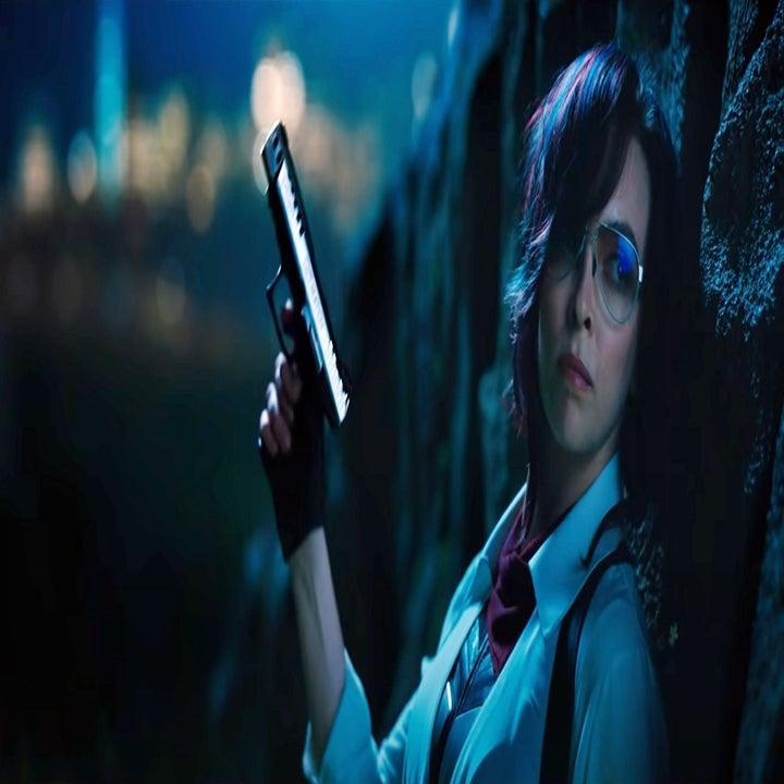 still image from the movie free guy where the character is holding a gun in her hand while looking pensively