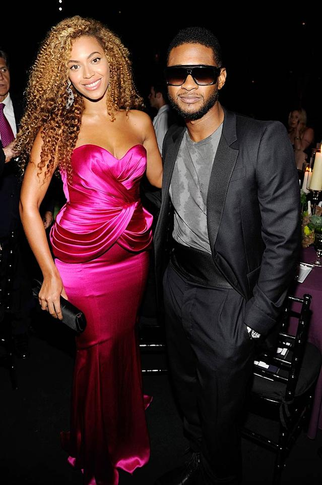 """Striking a pose with her pal Usher, Beyonce was fierce in 1980s-esque curls and a fuchsia Andrew Gn gown. Do you think Bey's pink gown is hot ... or a hot mess? Kevin Mazur/Child/<a href=""""http://www.wireimage.com"""" target=""""new"""">WireImage.com</a> - September 30, 2010"""