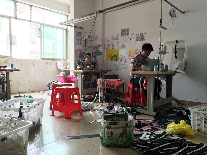 Workers at a small-sized factory producing bags at Shiling town in Huadu