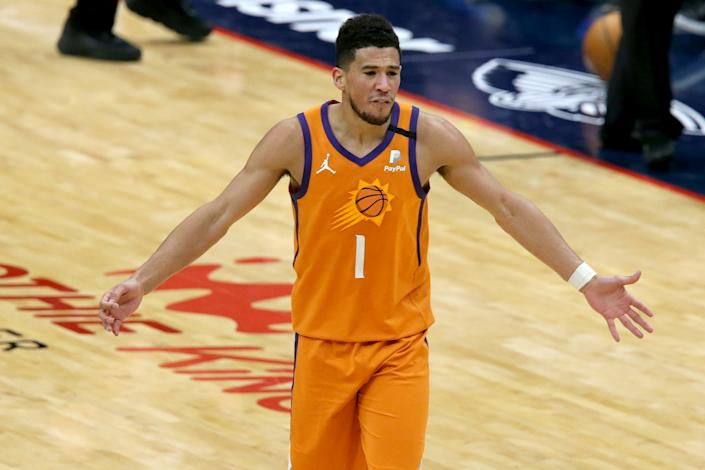 Devin Booker is the leading scorer for the fourth-place Phoenix Suns. (Sean Gardner/Getty Images)