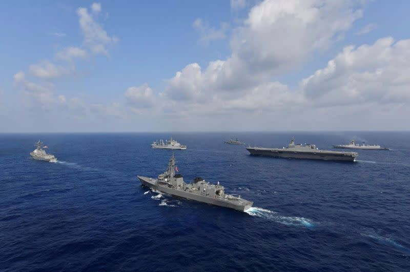 FILE PHOTO: Vessels from the U.S. Navy, Indian Navy, Japan Maritime Self-Defense Force and the Philippine Navy sail in formation at sea
