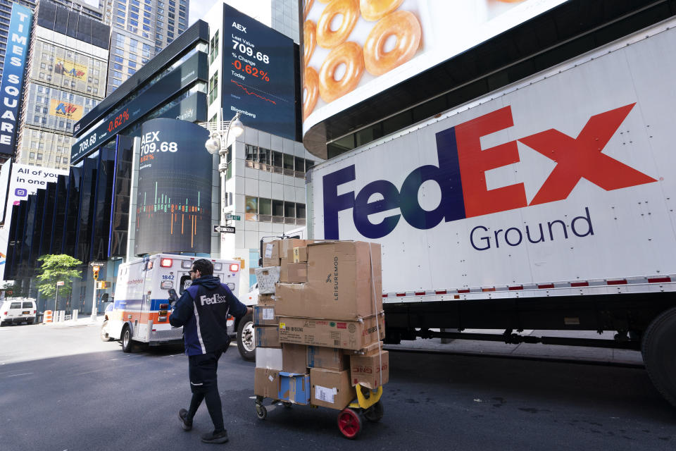 A FedEx driver delivers a parcel cart Thursday, May 6, 2021 in New York City.  (AP Photo / Mark Lennihan)