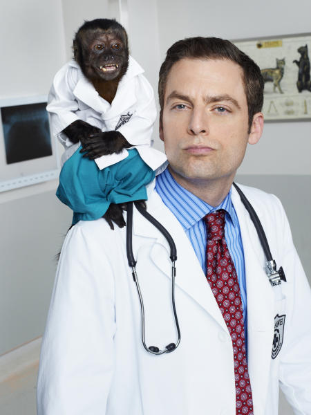 """This image released by NBC shows Crystal as Dr. Zaius, Justin Kirk as Dr. George Coleman -from the NBC comedy """"Animal Practice,"""" premiering Sept. 26 at 8 p.m. EST. (AP Photo/NBC, Chris Haston)"""