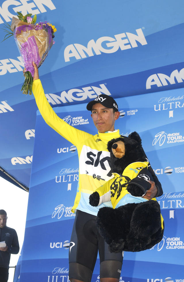 Bernal Gomez, of Colombia, waves to fans as he wears his Race Leader Jersey after winning Stage 2 of the AMGEN Tour of California Monday, May 14, 2018, in Santa Barbara, Calif. (AP Photo/Mark J. Terrill)