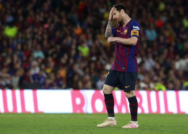 Barcelona forward Lionel Messi reacts during the Copa del Rey soccer match final between Valencia CF and FC Barcelona at the Benito Villamarin stadium in Seville, Spain, Saturday. 25, 2019. (AP Photo/Miguel Morenatti)