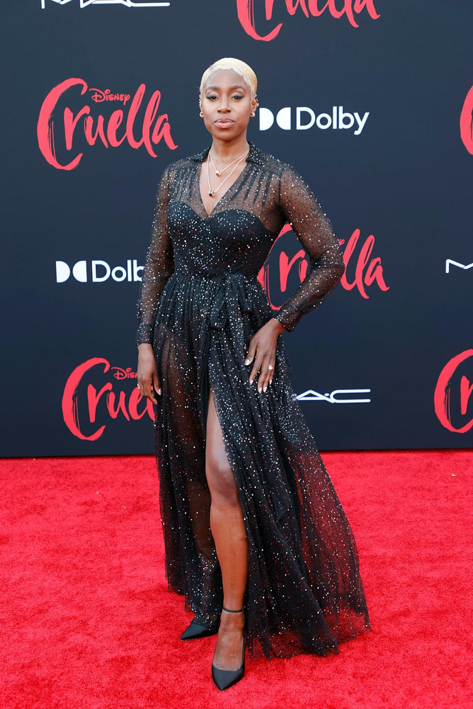 Kirby wore a starry black gown to the <em>Cruella</em> premiere. It had a solid black bodysuit and sparkly mesh fabric over the bodice and skirt.