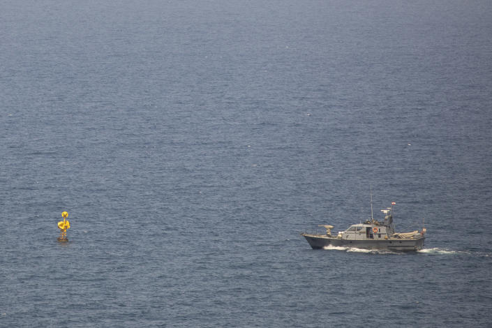 A Lebanese Navy vessel patrols in the Mediterranean Sea, as seen from Rosh Hanikra border crossing between Israel and Lebanon in northern Israel, Tuesday, May 4, 2021. Lebanon and Israel have resumed indirect talks with U.S. mediation at a U.N. post along the border known as Ras Naqoura over their disputed maritime border after nearly a six-month pause. (AP Photo/Ariel Schalit)