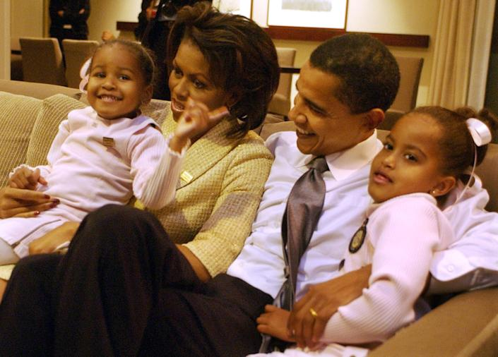 """""""I feel real good about 5-0,"""" President Obama says. """"I've gotten a little grayer since I took this job but otherwise, I feel pretty good."""" Then-Senate candidate (and gray-free) Barack Obama, with his wife, Michelle and theirs daughters Sasha and Malia wait for election returns on Nov. 2, 2004. (Now AP Photo/M. Spencer Green)"""