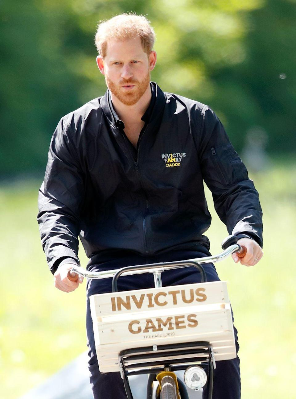 <p>Prince Harry rides around Sportcampus Zuiderpark on an Invictus Games bicycle. </p>