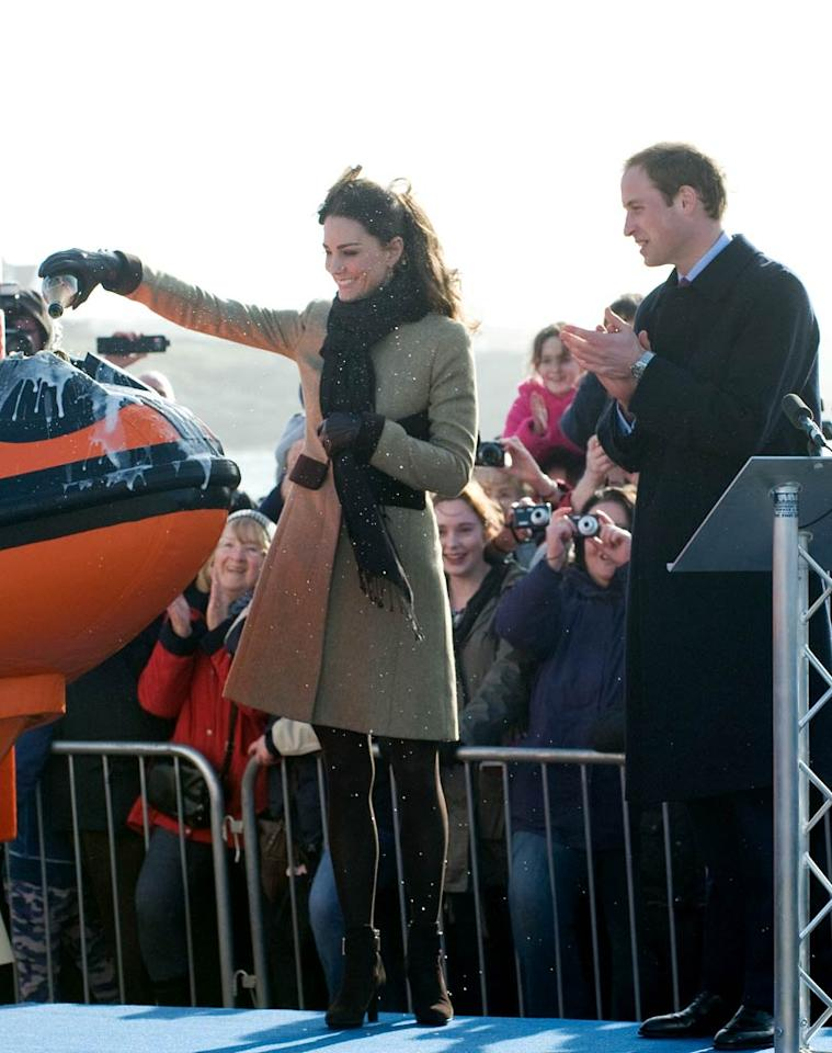 "Over in Wales, Charles' son Prince William and his fiancee Kate Middleton were performing their own royal duties when they officially launched the new RNLI lifeboat ""Hereford Endeavour"" on Thursday. The boat christening was Kate's first official duty as a royal. Samir Hussein/<a href=""http://www.wireimage.com"" target=""new"">WireImage.com</a> - February 24, 2011"