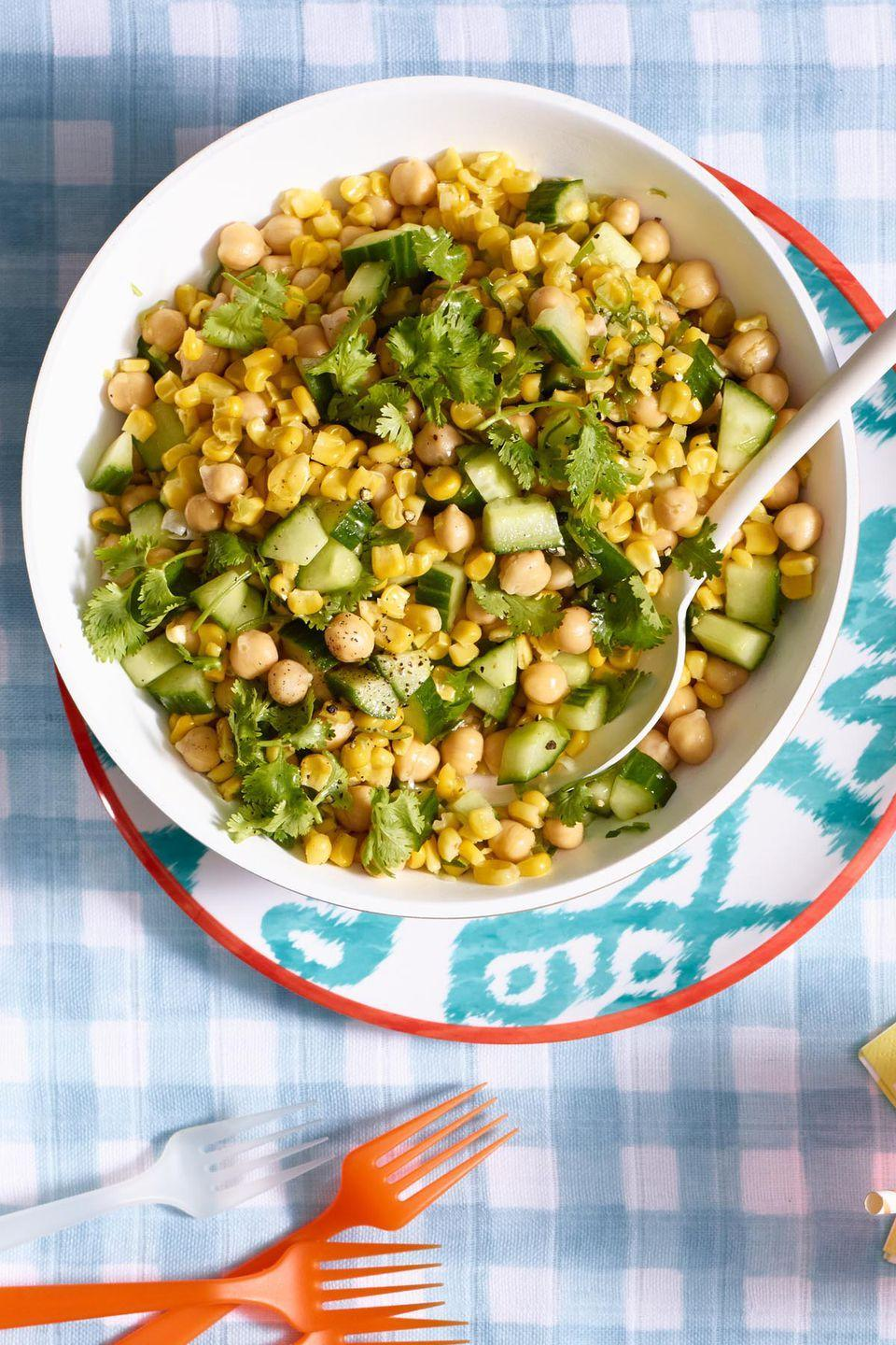 "<p>Move over, lettuce: Combine some of the best flavors of summer in this hearty bowl. </p><p><a href=""https://www.womansday.com/food-recipes/food-drinks/recipes/a55342/fresh-corn-and-chickpea-salad-recipe/"" rel=""nofollow noopener"" target=""_blank"" data-ylk=""slk:Get the recipe for Fresh Corn and Chickpea Salad."" class=""link rapid-noclick-resp""><em>Get the recipe for Fresh Corn and Chickpea Salad.</em></a> </p>"