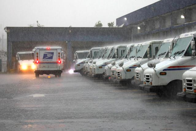 <p>U.S. Postal Service trucks are seen under heavy rain, weeks after Hurricane Maria hit Puerto Rico, in San Juan, Puerto Rico, Oct. 6, 2017. (Photo: Carlos Barria/Reuters) </p>