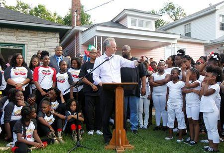 Louisville mayor Greg Fischer speaks at a community memorial service to celebrate the life of Muhammad Ali outside his childhood home in Louisville