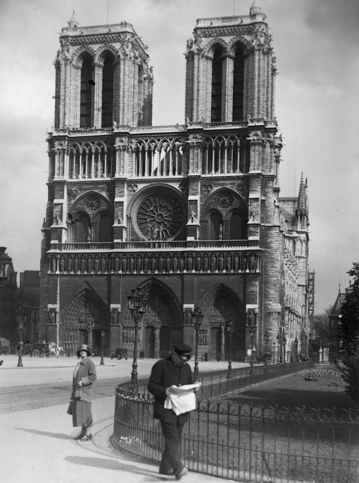 circa 1920: West front of Notre Dame in Paris with its three French Gothic arched doorways.