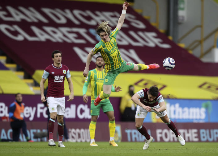 West Bromwich Albion's Conor Gallagher is challenged by Burnley's Ashley Westwood, right, during the English Premier League soccer match between Burnley and West Bromwich Albion at Turf Moor stadium in Burnley, England, Saturday, Feb. 20, 2021. (Martin Rickett/Pool via AP)