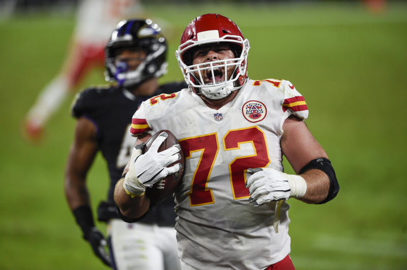 Kansas City Chiefs offensive tackle Eric Fisher (72) celebrates his touchdown catch during the second half of an NFL football game against the Baltimore Ravens, Monday, Sept. 28, 2020, in Baltimore. (AP Photo/Gail Burton)