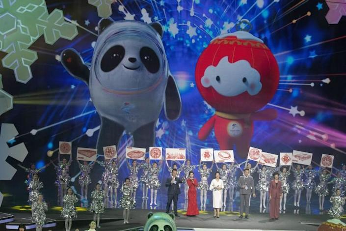 Beijing 2022 Winter Olympic Mascot Bing Dwen Dwen, left and 2022 Winter Paralympic Games mascot Shuey Rong Rong are revealed during a ceremony held at the Shougang Ice Hockey Arena in Beijing on Tuesday, Sept. 17, 2019. (AP Photo/Ng Han Guan)