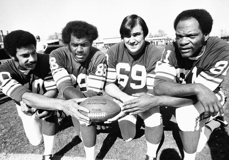 FILE - This Jan. 9, 1975, file photo shows from left, Minnesota Vikings defensemen Jim Marshall, Alan Page, Doug Sutherland and Carl Eller. Purple People Eaters _ The bruising Minnesota Vikings defensive line from the late 1960s through the 1970s. Members included Hall of Famer Alan Page, Carl Eller and Jim Marshall. If not for going 0-4 in Super Bowls, the group likely would be more celebrated. (AP Photo/File)