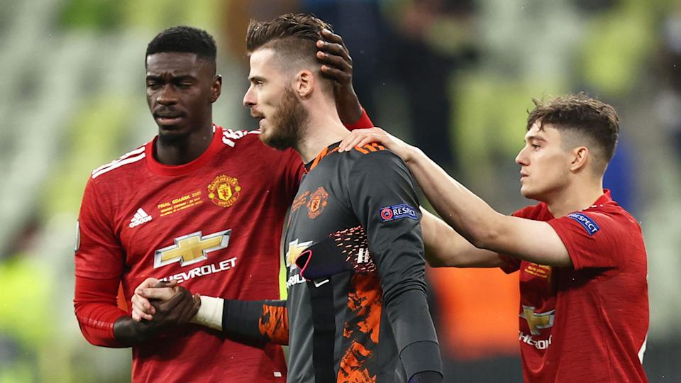 Manchester United teammates are pictured here comforting David de Gea after the Europa League final.