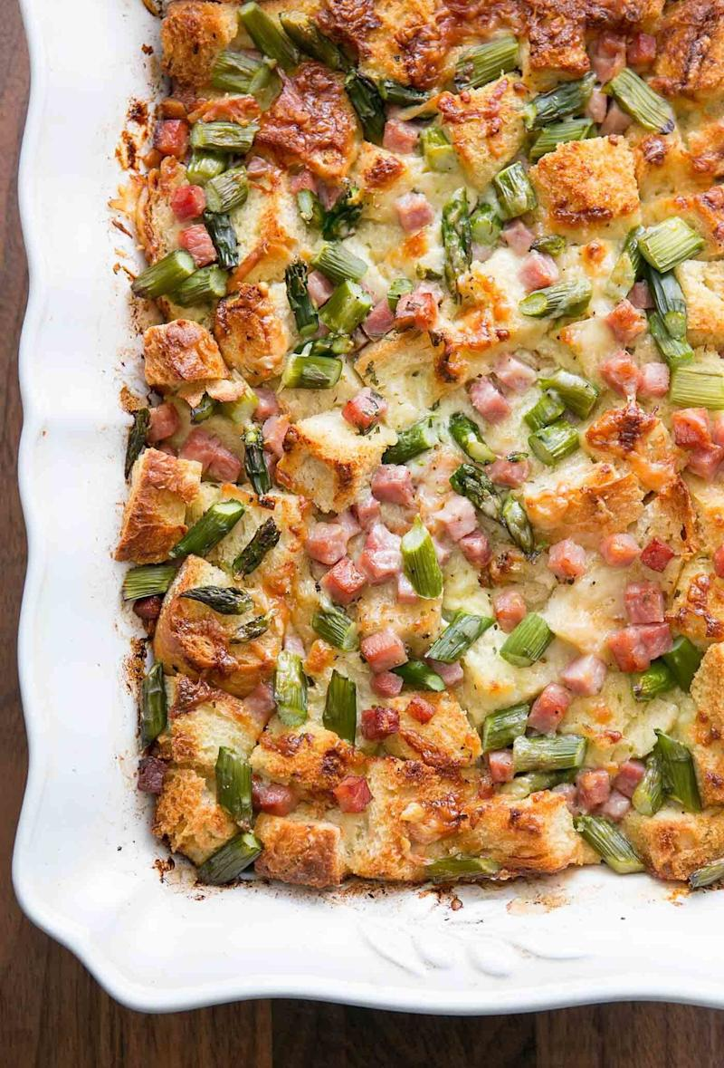 "<strong>Get the <a href=""https://www.simplyrecipes.com/recipes/ham_and_asparagus_strata/"" target=""_blank"">Ham And Asparagus Strata</a> recipe from Simply Recipes.</strong>"
