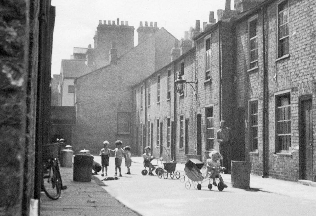 <p>Multiple occupancy terraced housing in Gothic Street, Cambridge, 1950s. Few cars and gardens meant children played in the street (mediadrumworld/Caters) </p>