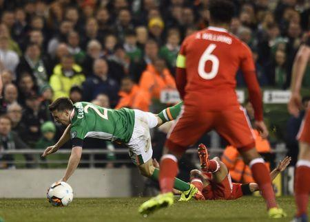 Football Soccer - Republic of Ireland v Wales - 2018 World Cup Qualifying European Zone - Group D - Aviva Stadium, Dublin, Republic of Ireland - 24/3/17 Republic of Ireland's Seamus Coleman is fouled by Wales' Neil Taylor Reuters / Clodagh Kilcoyne Livepic