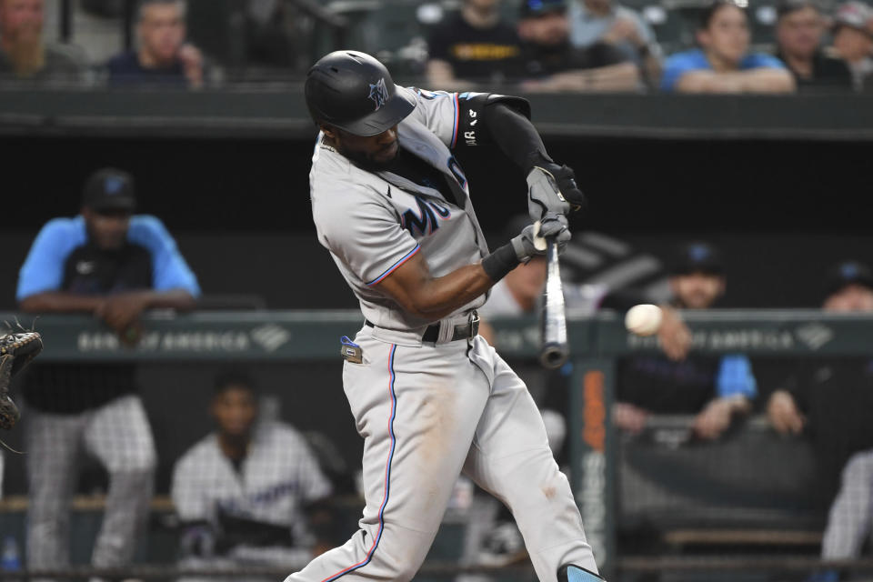 Miami Marlins' Starling Marte hits an RBI single during the fourth inning off Baltimore Orioles starting pitcher Spenser Watkins in a baseball game Tuesday, July 27, 2021, in Baltimore. (AP Photo/Terrance Williams)