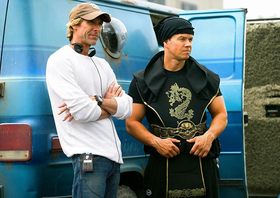 """Director Michael Bay and Mark Wahlberg on the set of Paramount Pictures' """"Pain & Gain"""" - 2013"""