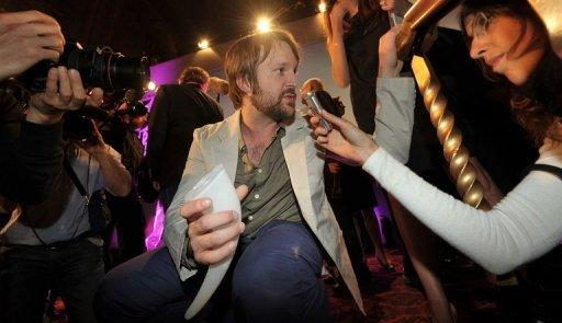 Chef Rene Redzepi (C) of Danish restaurant Noma speaks to the media after winning first place at the S.Pellegrino 'World's 50 Best Restaurants Awards 2011', in central London. He won the same award this year for the third time in a row