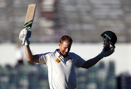 Australia's Adam Voges celebrates reaching his century during the fourth day of the second cricket test match against New Zealand at the WACA ground in Perth, Western Australia, November 16, 2015.  REUTERS/David Gray/File Photo