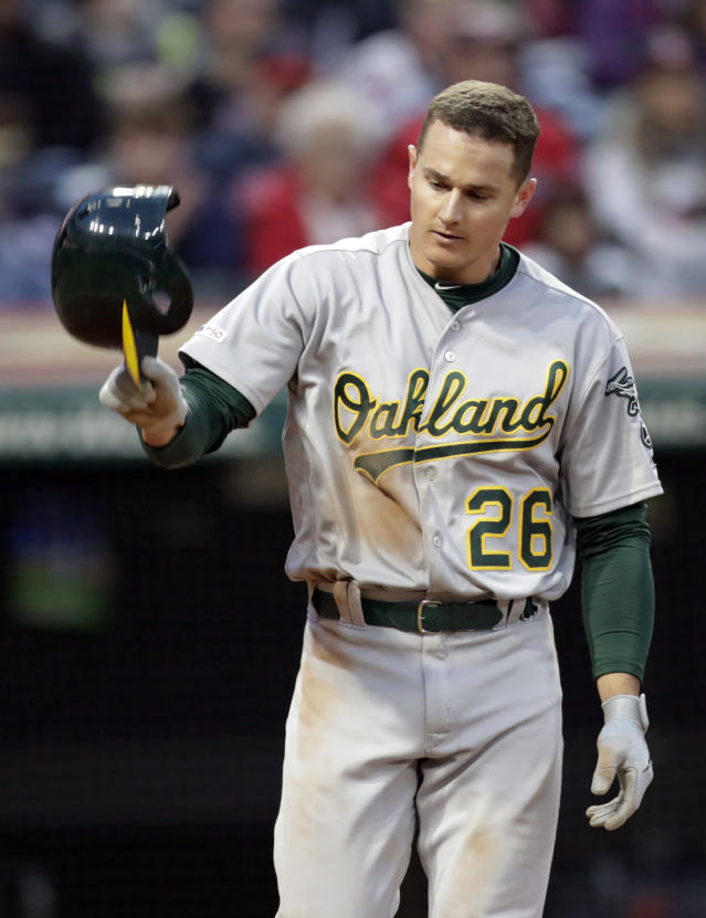 Oakland Athletics' Matt Chapman throws his helmet after striking out against Cleveland Indians starting pitcher Trevor Bauer in the sixth inning of a baseball game, Tuesday, May 21, 2019, in Cleveland. (AP Photo/Tony Dejak)