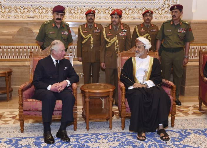 In this photo made available by Oman News Agency, Oman's new Sultan Haitham bin Tariq Al Said, right, receives The Prince of Wales after his arrival to attend the late Sultan Qaboos official mourning ceremony, in Muscat, Oman, Sunday, Jan. 12, 2020. (Oman News Agency via AP)