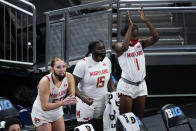Maryland's Chloe Bibby (55), Ashley Owusu (15) and Diamond Miller (1) celebrate on the sideline during the second half of an NCAA college basketball semifinal game against Northwestern at the Big Ten Conference tournament, Friday, March 12, 2021, in Indianapolis. Maryland won 85-52. (AP Photo/Darron Cummings)