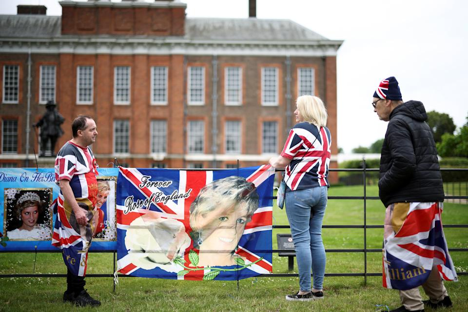 Royalists draped flags outside Kensington Palace in tribute to Princess Diana. (REUTERS)