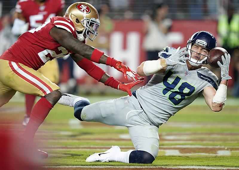 SANTA CLARA, CALIFORNIA - NOVEMBER 11: Tight end Jacob Hollister #48 of the Seattle Seahawks catches a pass for a touchdown over strong safety Jaquiski Tartt #29 of the San Francisco 49ers in the third quarter of the game at Levi's Stadium on November 11, 2019 in Santa Clara, California. (Photo by Thearon W. Henderson/Getty Images)