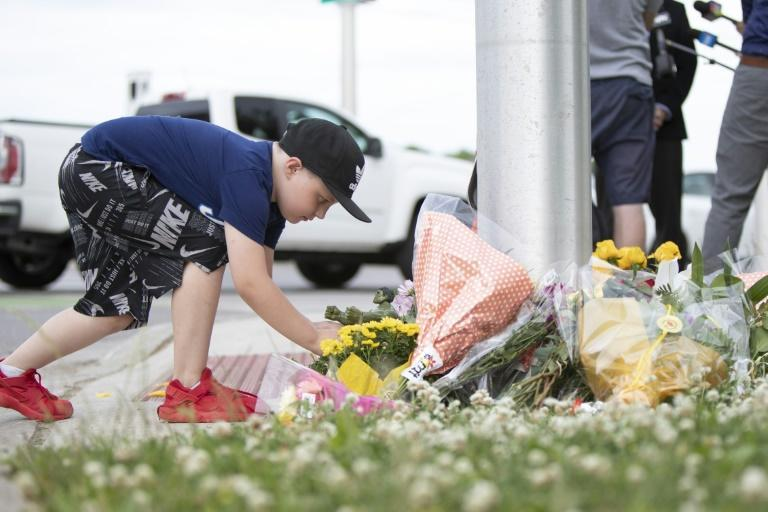 A boy leaves an action figure for the nine-year-old hospitalized after an attack in Ontario, Canada