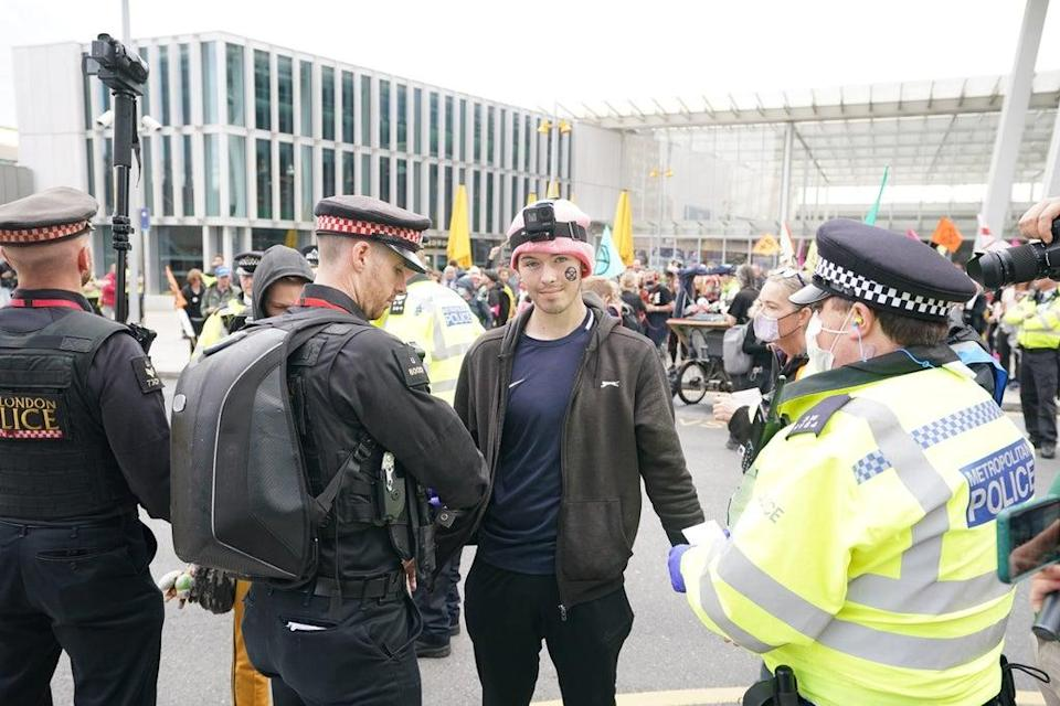 Police and demonstrators during a protest by members of Extinction Rebellion at London Bridge station(Ian West/PA) (PA Wire)