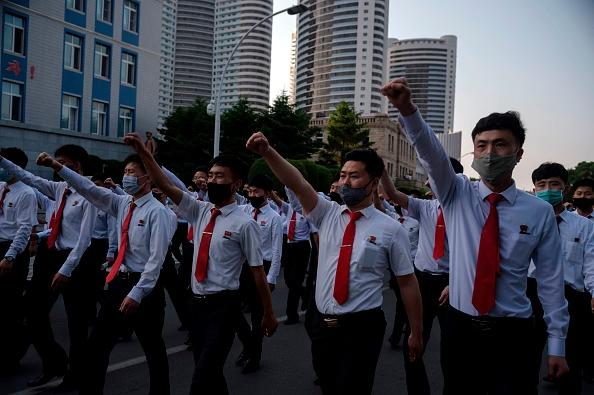 North Korean students take part in a rally denouncing 'defectors from the North' as they march from the Pyongyang Youth Park Open-Air Theatre to Kim Il Sung Square in Pyongyang.