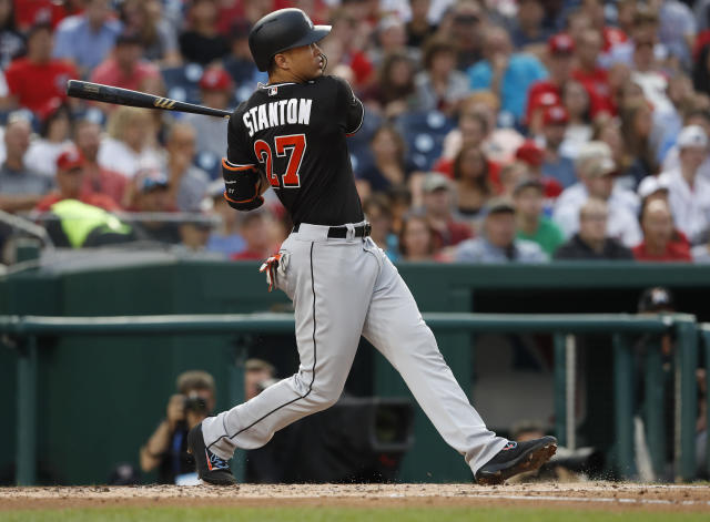 "<a class=""link rapid-noclick-resp"" href=""/mlb/players/8634/"" data-ylk=""slk:Giancarlo Stanton"">Giancarlo Stanton</a> thinks the Marlins could compete, but ownership wants to slash payroll instead. (AP Photo)"