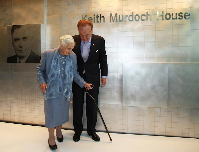 FILE - In this Nov. 16, 2005 file photo, News Corp. Chief Executive Rupert Murdoch, right, walks alongside his mother Dame Elisabeth Murdoch at the opening of a new newspaper office building named after his father Keith Murdoch, in Adelaide, Australia. Dame Elisabeth, a prominent Australian philanthropist, died on Wednesday, Dec. 5, 2012 at age 103. (AP Photo/Bryan Charlton, File)