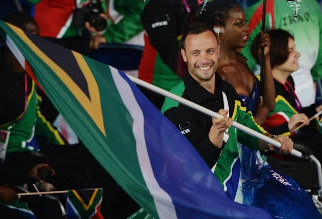 LONDON, ENGLAND - AUGUST 29: Athlete Oscar Pistorius of South Africa carries the flag during the Opening Ceremony of the London 2012 Paralympics at the Olympic Stadium on August 29, 2012 in London, England. (Photo by Gareth Copley/Getty Images)