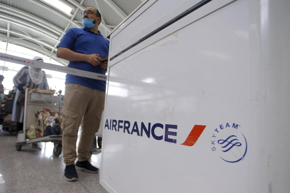 A traveler queues at the Houari Boumediene airport for a flight bound to Paris, Tuesday, June 1, 2021 in Algiers. Algeria has partially reopened its air borders Tuesday for the first time in over 15 months of the COVID-19 crisis. (AP Photo/Fateh Guidoum)