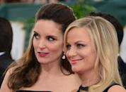 Tina Fey (L) and Amy Poehler are set to host the Golden Globes once again this year, but presumably without the event's trademark raucous A-lister crowd and party atmosphere